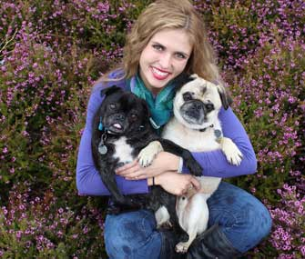 Mikkel Becker and her Pugs, Bruce and Willy