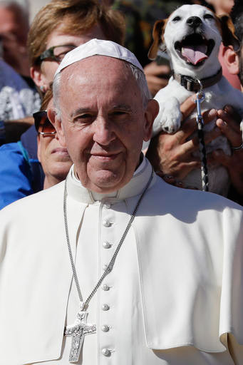 Dog photobombs Pope