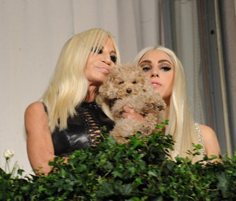 Donatella Versace and Lady Gaga pose with Fozzi Bear the Labradoodle