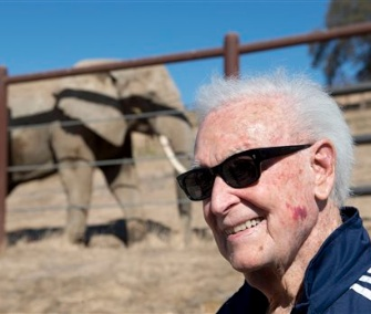 Former game show host Bob Barker visits the three elephants in California on Monday.