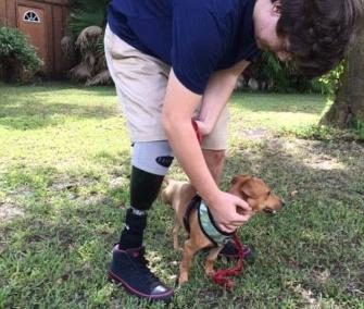 Sam Sartain, 16, pets his new dog, Pooh.