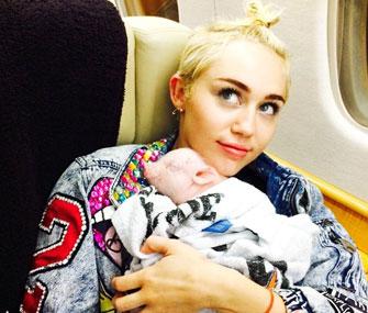 Miley Cyrus adopts a pig