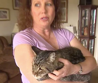Elizabeth Corso holds her long-lost pet, Bandit.