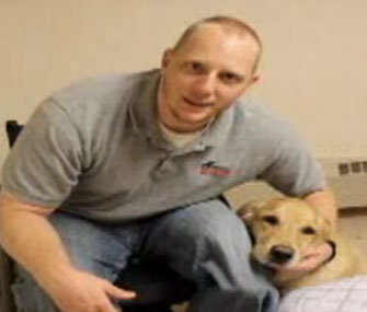 Navy veteran Joseph Worley with his service dog, Benjamin.