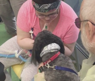 Emily Reimer, 19, was reunited with her dogs at St. Louis Children's Hospital this month.