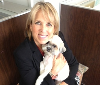 Rep. Michelle Lujan Grisham is happy to be reunited with Kiwi.